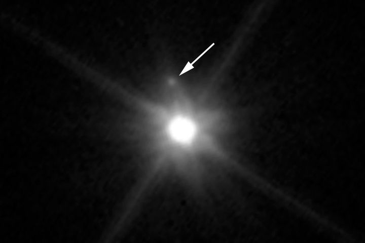 This Hubble Space Telescope image reveals the first moon ever discovered around the dwarf planet Makemake. The tiny moon, loc