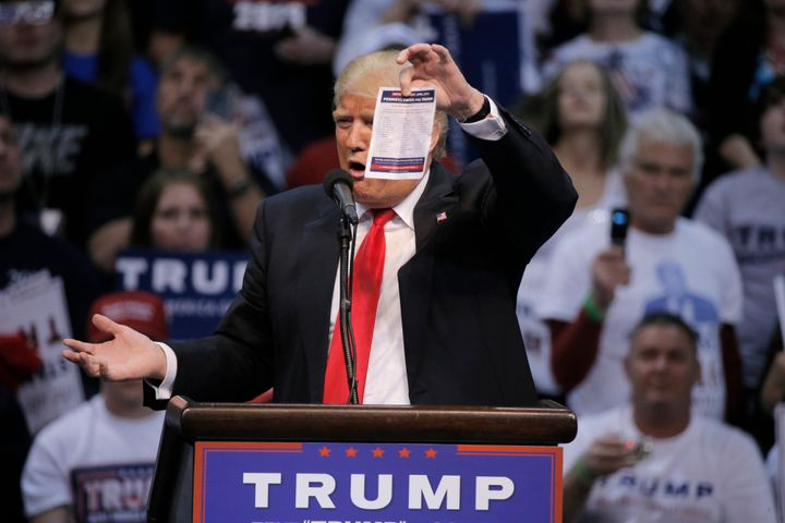 Republican U.S. presidential candidate Donald Trump shows the delegates list for the Pennsylvania state primary election duri