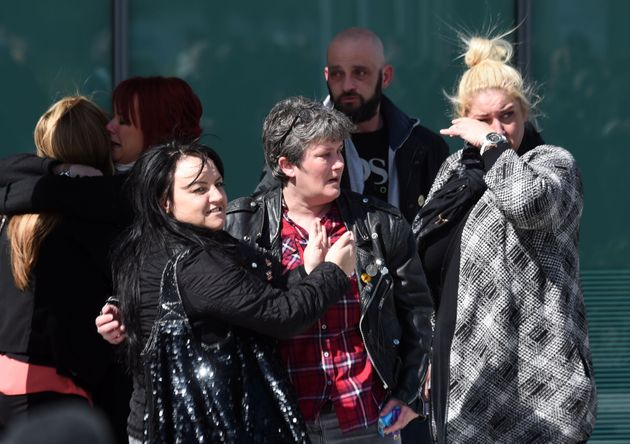 Relatives hug outside the Hillsborough inquests in Warrington, where the inquest jury concluded that...