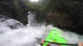 Edward Muggridge goes over a waterfall in a kayak.