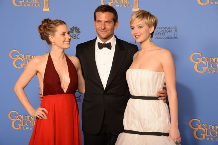 Amy Adams and Jennifer Lawrence pose with a man who earned more money than them for doing the same job in the same
