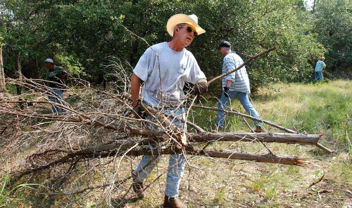 President George W. Bush often made sure to be spotted doing hard work around his ranch, projecting the rugged image he worke