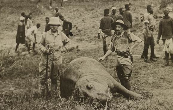 What's more manly than renowned outdoorsman Theodore Roosevelt standing with a rifle next to a dead hippopotamus?