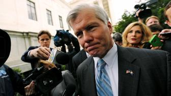 Former Virginia Governor Bob McDonnell is trailed by reporters as he departs after his appeal of his 2014 corruption conviction was heard at the U.S. Supreme Court in Washington, U.S. April 27, 2016. REUTERS/Jonathan Ernst