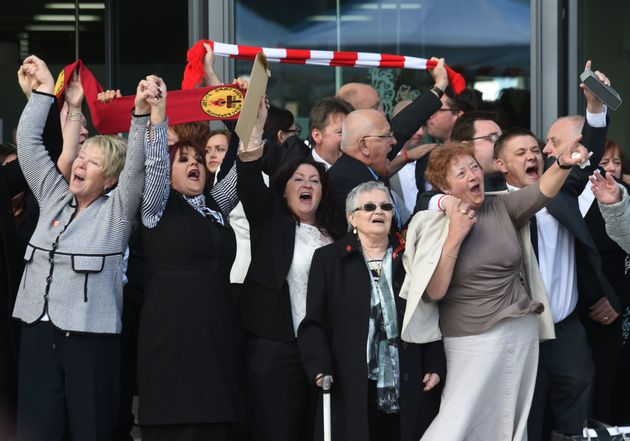 Relatives of those who died in the Hillsborough disaster sing 'You'll Never Walk Alone' outside the Hillsborough...