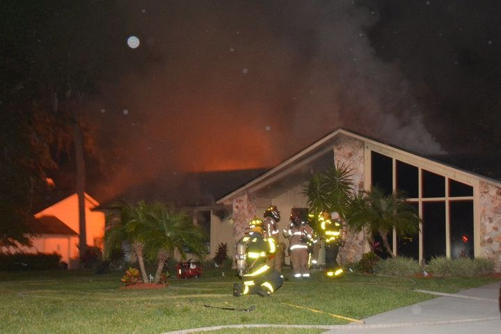 Firefighters are seen at the home of a Seminole County Sheriff's deputy Monday night after a fire broke out behind the house.
