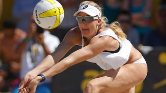 HUNTINGTON BEACH, CA - SEPTEMBER 21:  Kerri Walsh Jennings digs the ball during the women's final against Heather Hughes and Whitney Pavlik at the AVP Championships at Huntington Beach on September 21, 2014 in Huntington Beach, California.  (Photo by Joe Scarnici/Getty Images)