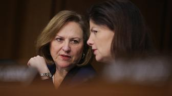 WASHINGTON, DC - APRIL 05:  Senate Armed Services Committee members Sen. Deb Fischer (R-NE) (L) and Sen. Kelly Ayotte (R-NH) prepare to hear testimony from U.S. Cyber Command head and NSA Director Navy Adm. Michael Rogers in the Hart Senate Office Building on Capitol Hill April 5, 2016 in Washington, DC. When asked by McCain if Russia has the capability to inflict harm on the United States' cyber infrastructure, Rogers replied, 'Yes.'  (Photo by Chip Somodevilla/Getty Images)