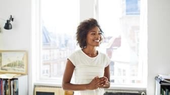 Creative businesswoman laughing in office space