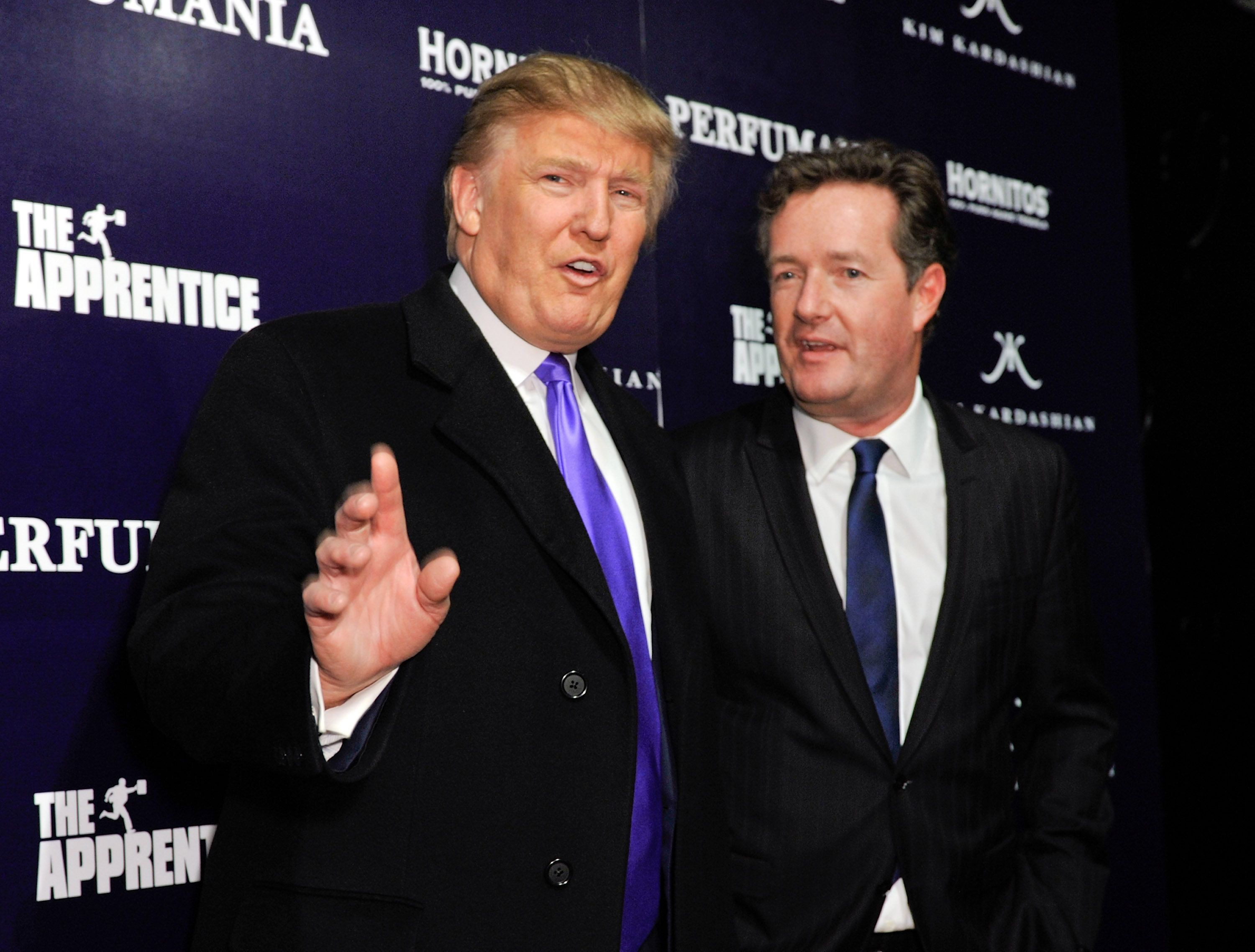 Donald Trump and Piers Morgan celebrate Perfumania's appearance with Kim Kardashian on 'The Apprentice' at Provacateur on November 10, 2010 in New York City. (Photo by D Dipasupil/WireImage)