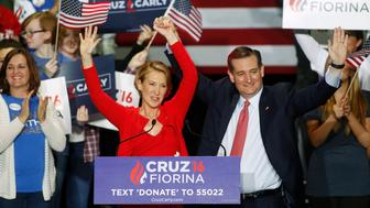 Republican U.S. presidential candidate Ted Cruz stands with Carly Fiorina after he announced Fiorina as his running mate at a campaign rally in Indianapolis, Indiana, United States April 27, 2016.  REUTERS/Aaron P. Bernstein