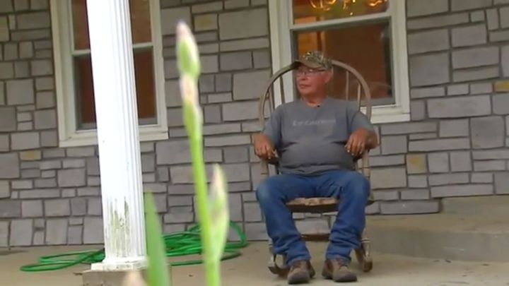 Martinez sitting n the porch of his new home.