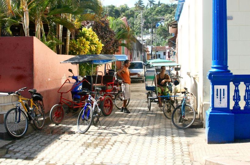 Rickshaw drivers<br>Baracoa, Cuba