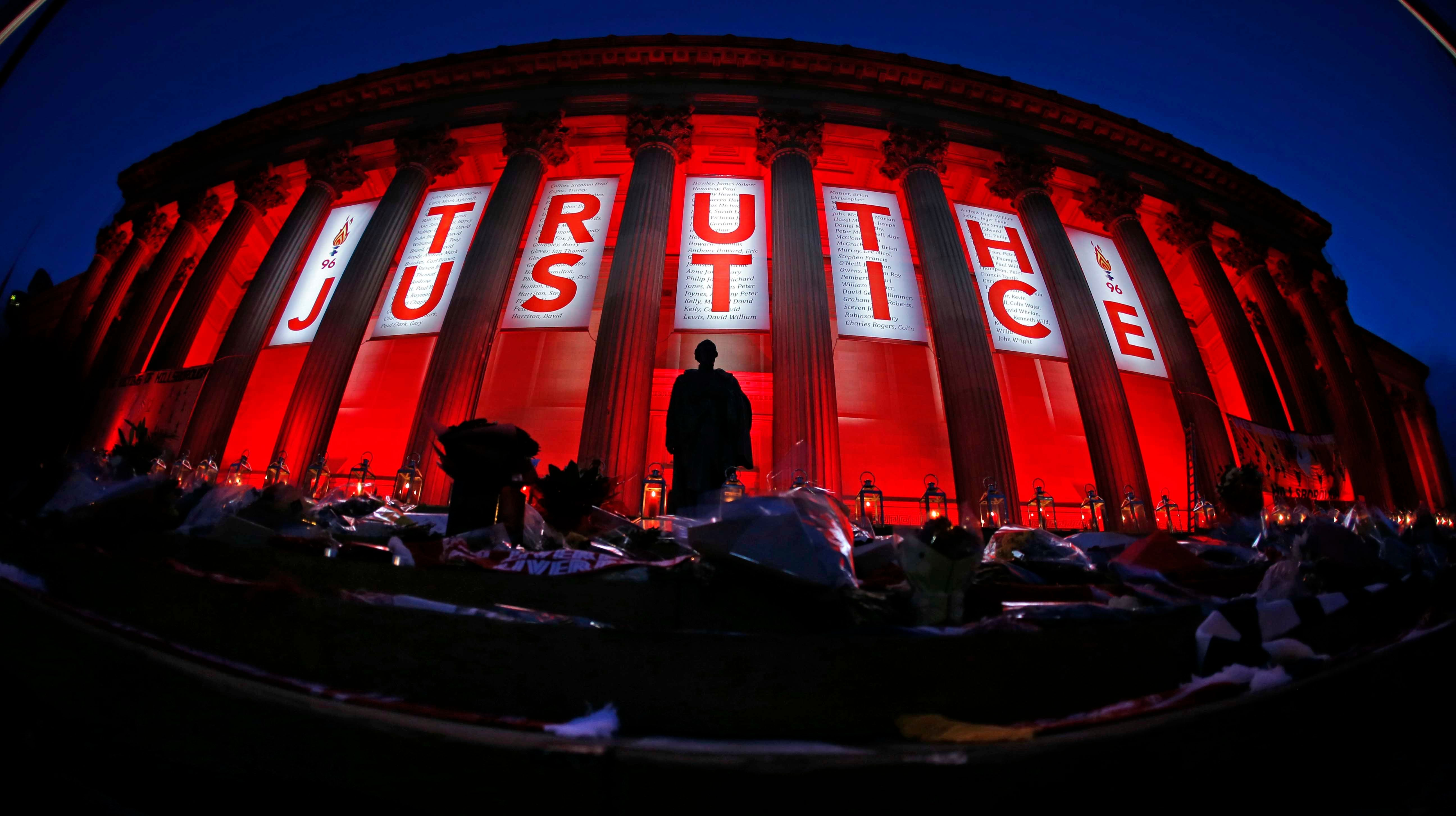 St George's Hall in Liverpool is illuminated following a special commemorative service to make the outcome...