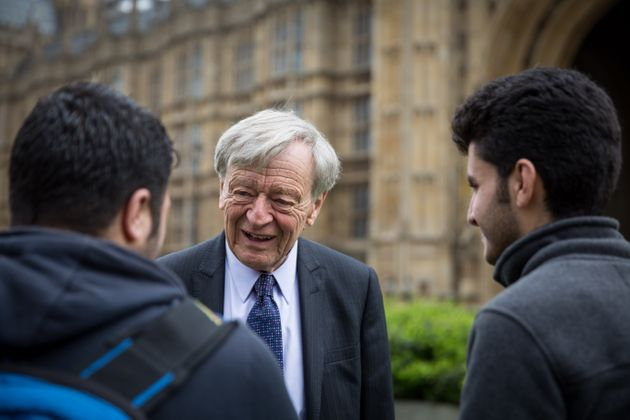 Lord Dubs meets two child refugees outisde parliament on