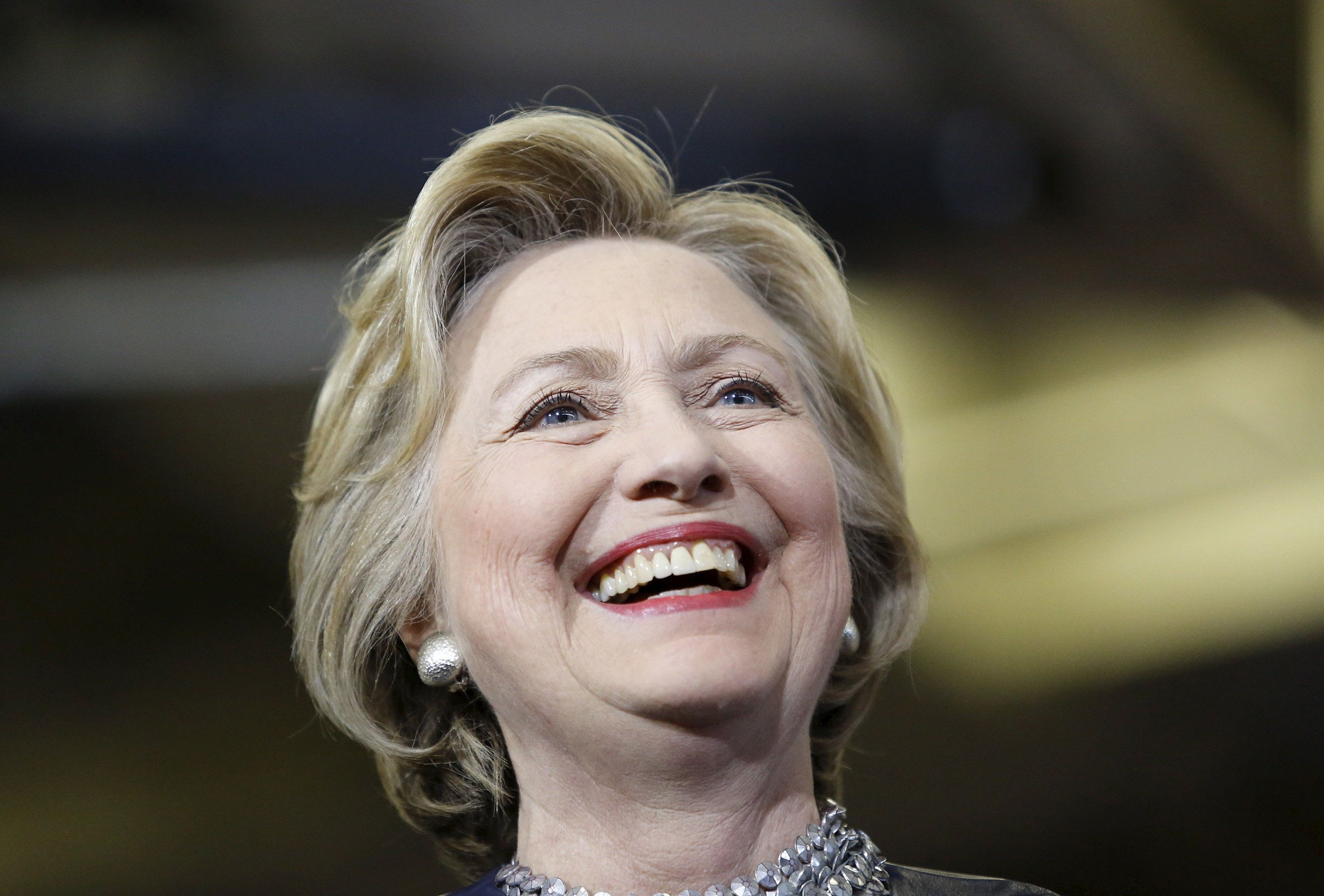U.S. Democratic presidential candidate Hillary Clinton smiles as she speaks during a campaign rally in Central Falls, Rhode Island, April 23, 2016.     REUTERS/Mary Schwalm