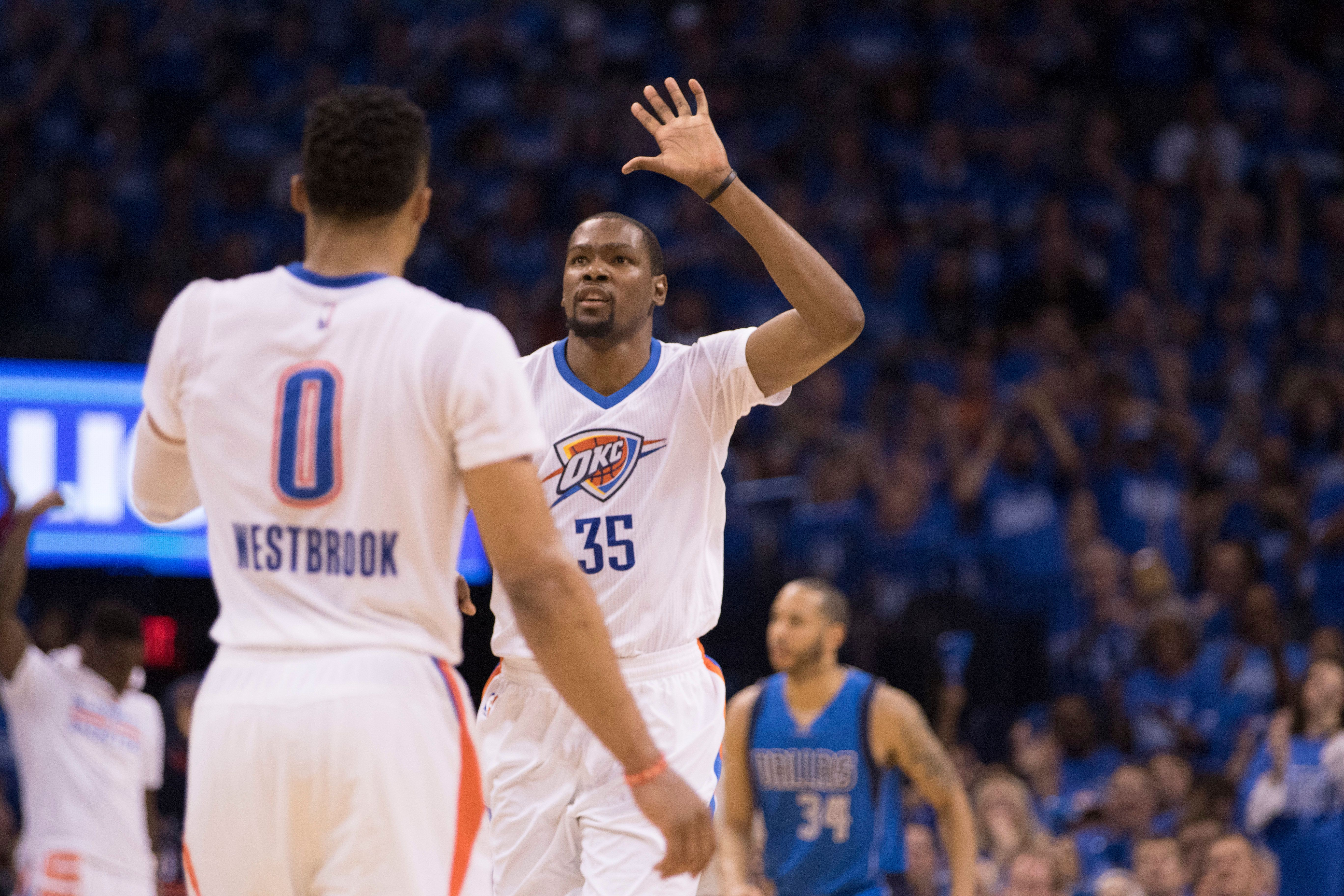 OKLAHOMA CITY, OK - APRIL 25: Kevin Durant #35 of the Oklahoma City Thunder and Russell Westbrook #0 of the Oklahoma City Thunder celebrate after defeating the Dallas Mavericks during Game Five of the Western Conference Quarterfinals during the 2016 NBA Playoffs at the Chesapeake Energy Arena on April 25, 2016 in Oklahoma City, Oklahoma.   NOTE TO USER: User expressly acknowledges and agrees that, by downloading and or using this photograph, User is consenting to the terms and conditions of the Getty Images License Agreement. (Photo by J Pat Carter/Getty Images)