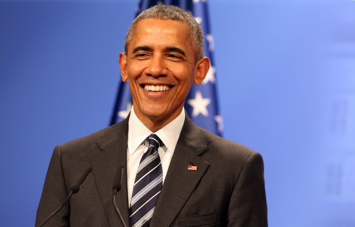 President Barack Obama smiling, presumably about Republican tax proposals.