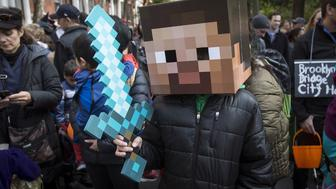 A child dressed as a character from Minecraft takes part in the Children's Halloween day parade at Washington Square Park in the Manhattan borough of New York October 31, 2015.   REUTERS/Carlo Allegri