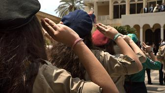 Armenian Youth Scouts salute Aram I Keshishian, the head of the Holy See of Cilicia of the Armenian Apostolic (Orthodox) Church during the Armenian Genocide commemoration ceremony in Antelias, Lebanon.