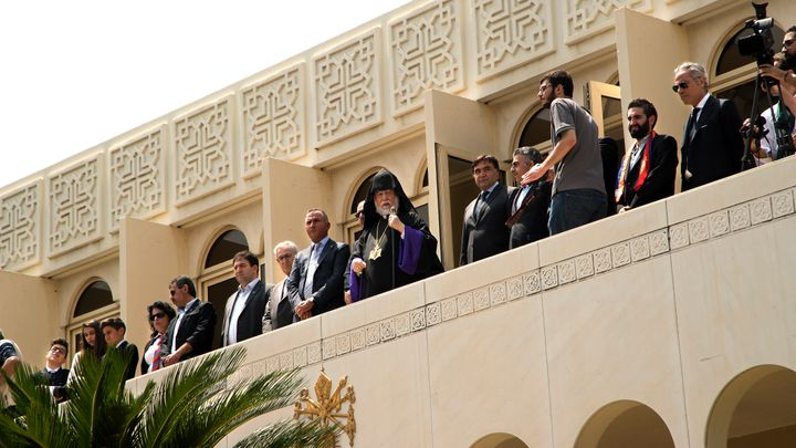 Aram I Keshishian (pictured centre), the head of the Holy See of Cilicia of the Armenian Apostolic (Orthodox) Church, watches