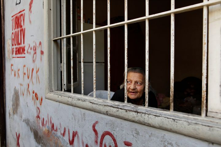 Imo Vik watches the day go by from her bedroom window in a back alley in central Bourj Hammoud.