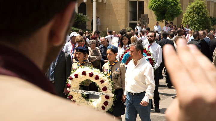 Armenian Youth Scouts lay a wreath in front of the Catholicosate of Cicilia Church in Antelias to commemorate those killed in