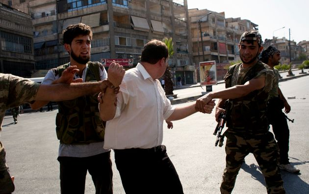 Shabiha extort some refugees for money or information, and threaten to harm the refugees' families back...