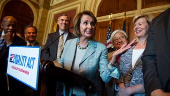 UNITED STATES - JULY 23: House Minority Leader Nancy Pelosi, D-Calif., during an event in the Capitol on the Equality Act that bans discrimination against LGBT people in federal law, July 23, 2015. Also appearing, from left, are Reps. John Lewis, D-Ga., David Cicilline, D-R.I.,  Sen. Jeff Merkley, D-Ore., Rep. Mike Honda, D-Calif., and Sen. Tammy Baldwin, D-Wisc. (Photo By Tom Williams/CQ Roll Call)