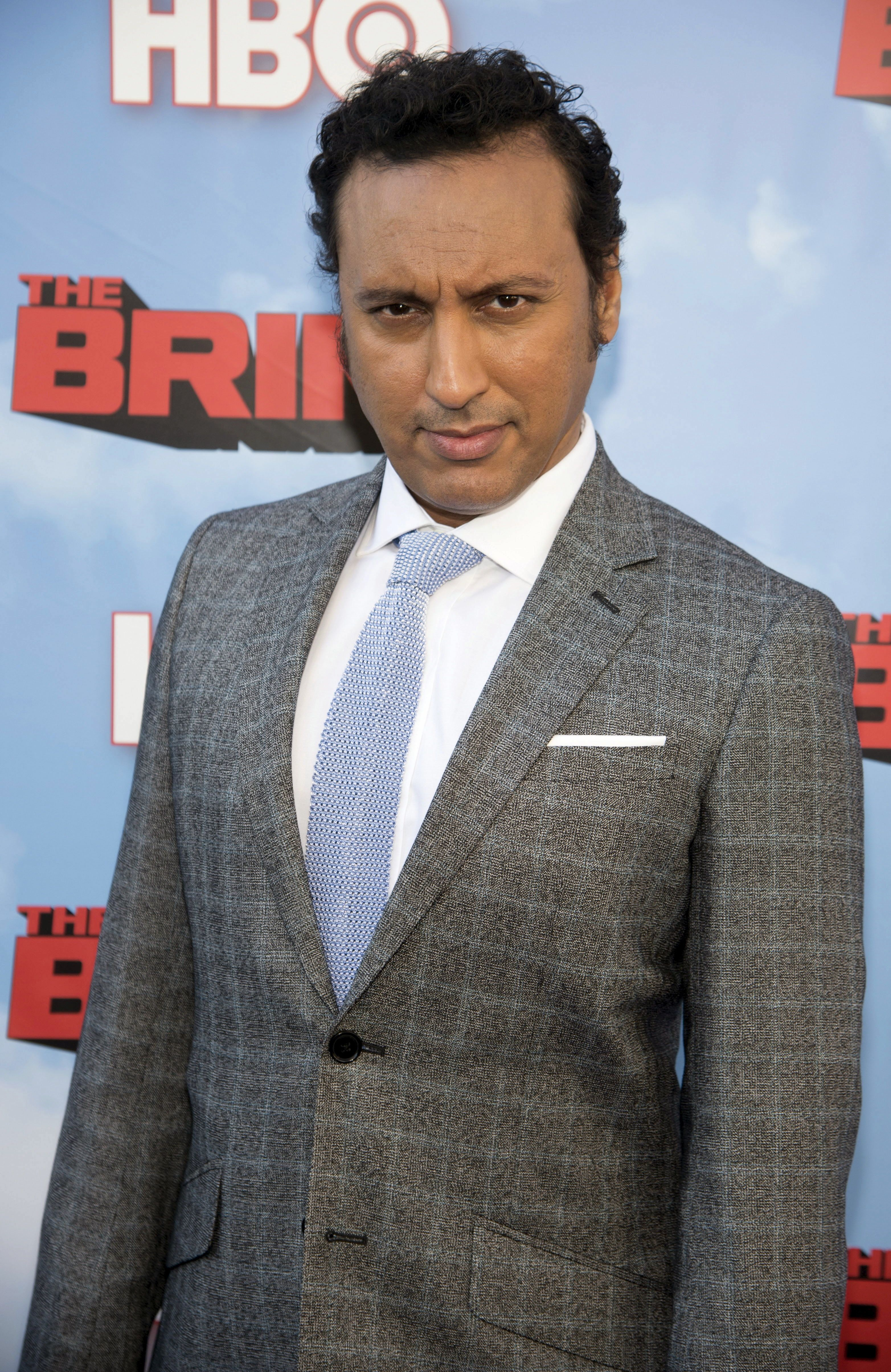 "Cast member Aasif Mandvi attends the premiere of the HBO comedy series ""The Brink"" in Los Angeles June 8, 2015. REUTERS/Phil McCarten"