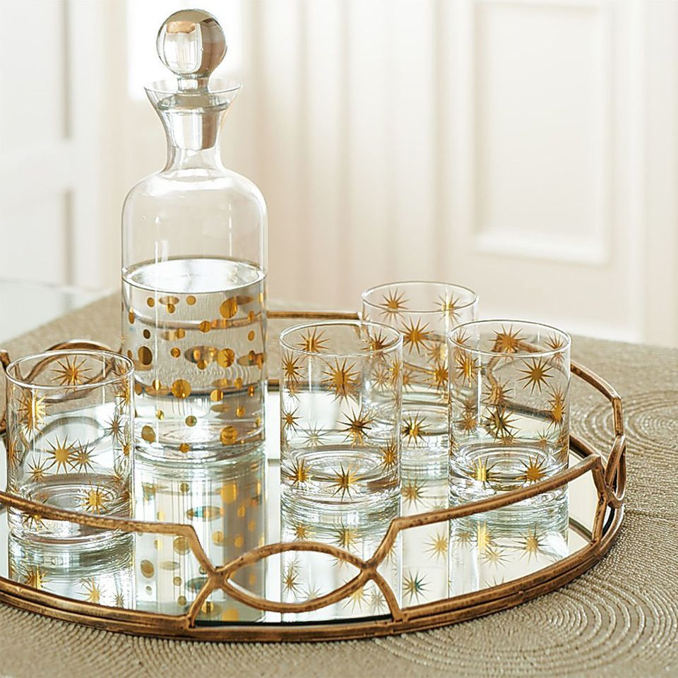 This geometric gold frame tray can serve multiple purposes -- from displaying glassware during dinner parties to organizing j