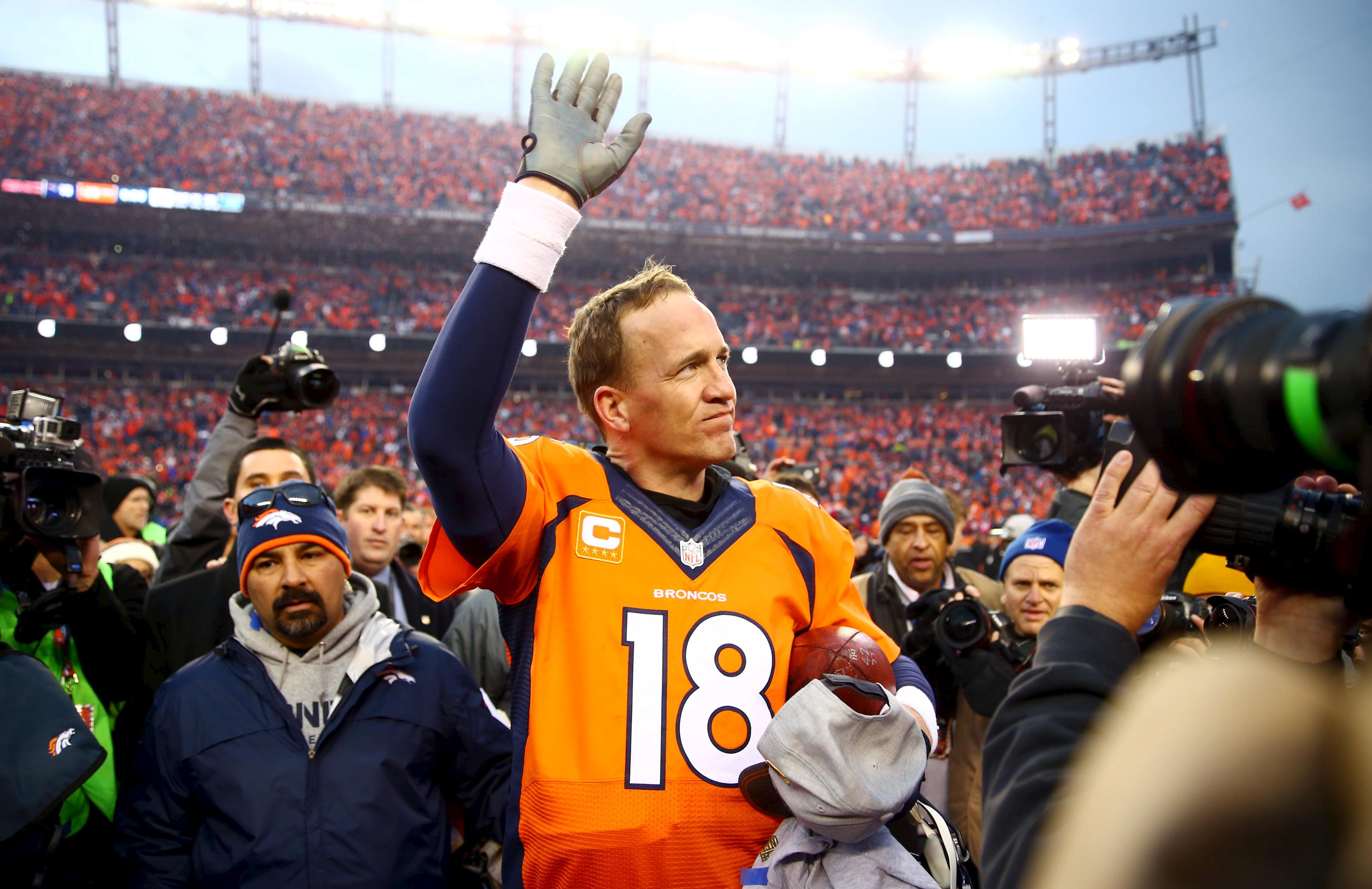 Peyton Manning waves to the crowd after the AFC Championship football game against the New England Patriots at Sports Authori