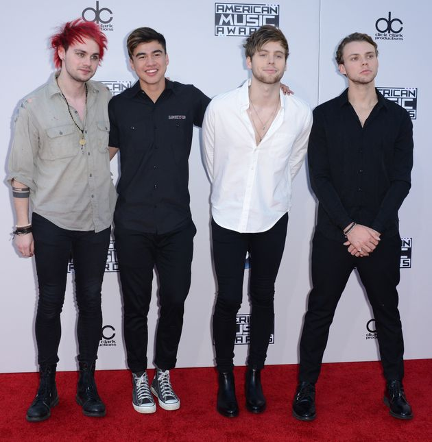 5 Seconds of Summer modelling skinny jeans at a premiere (file