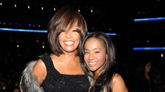 (EXCLUSIVE, Premium Rates Apply) LOS ANGELES, CA - NOVEMBER 22: *EXCLUSIVE* Whitney Houston and Bobbi Kristina Brown at the 2009 American Music Awards at Nokia Theatre L.A. Live on November 22, 2009 in Los Angeles, California.  (Photo by Kevin Mazur/AMA2009/WireImage)