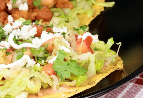 The open-faced sandwich of Mexican cuisine, tostadas often feature the same ingredients you find in tacos. The toppings in th