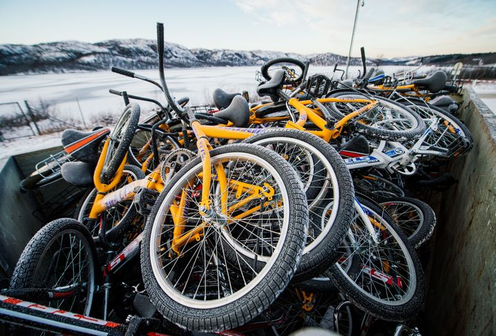 Refugees, mainly Syrian, cross the border from Russia into Norway on bikes.