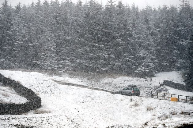 A car drives through snow near Nenthead in