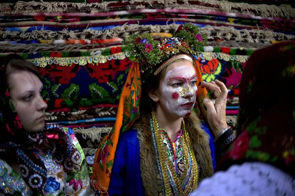 Emilia's face is painted in preparation for her wedding ceremony. This ritual painting is called 'gelina.""