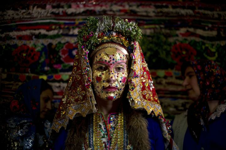 Emilia Pechinkova, a 24-year-old Bulgarian Pomak bride poses for a photograph following a face painting ceremony in the