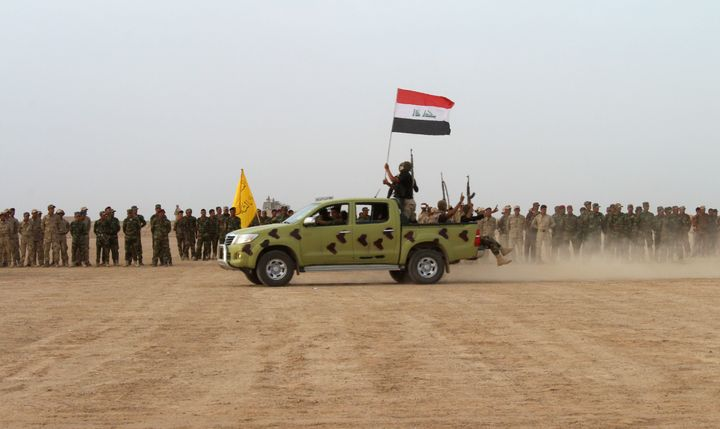 Iraqi security forces train near Fallujah, Iraq, in April. The city, under Islamic State control for over two years and