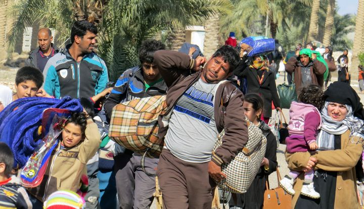 Iraqis flee Islamic State-controlled areas near Fallujah in February. The militant group has prevented people from