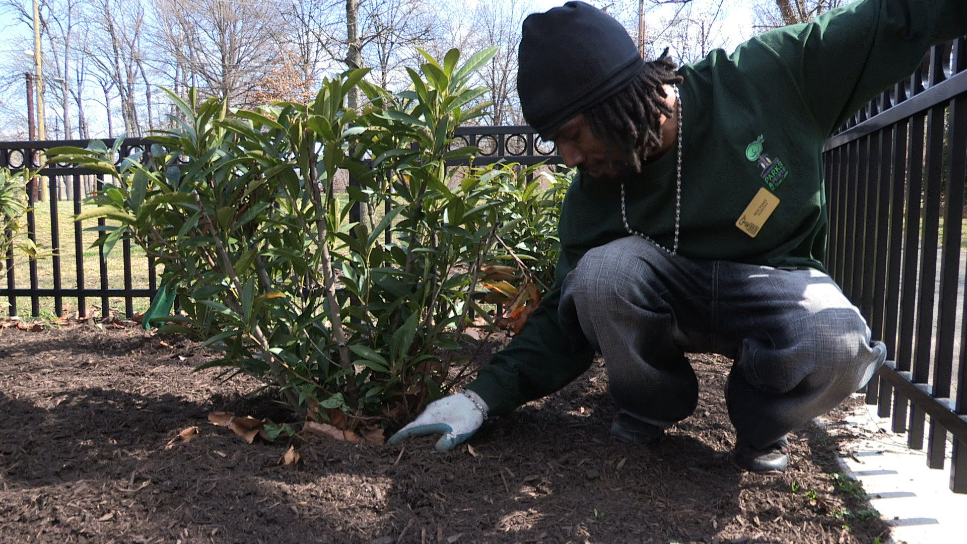 Michael Samuels tends to a plant in a Washington D.C. park as part of a job-training program for residents facing barrie