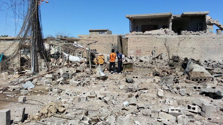 Abuilding in Fallujah destroyed byairstrikes in March. Iraqi forces fighting to wrest back control of Islamic Sta