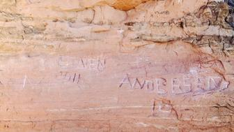 Graffiti discovered etched into Frame Arch at Arches National Park.
