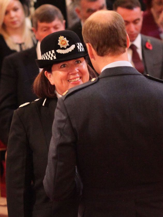 Dawn Copley is decorated with the Queen's Police Medal by Prince William at Buckingham Palace in