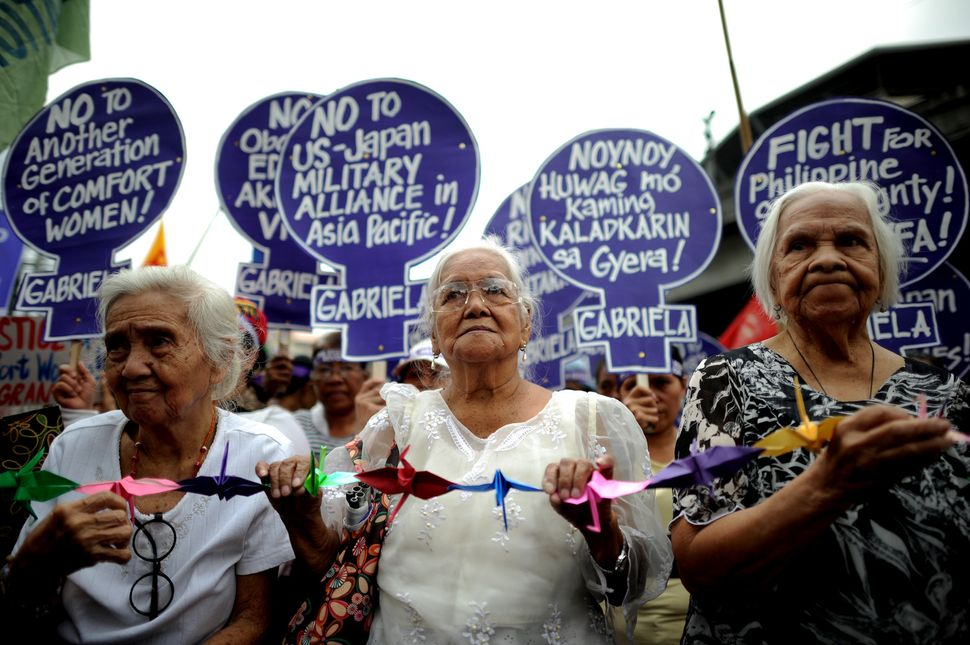 Lolas protest near the Malacanang Palace in Manila, where visiting Japanese Emperor Akihito met President of the Philippines