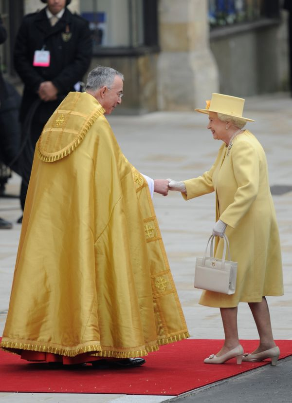 Queen Elizabeth II shakes hands withThe Right Reverend Dr. John Hall, Dean of Westminster