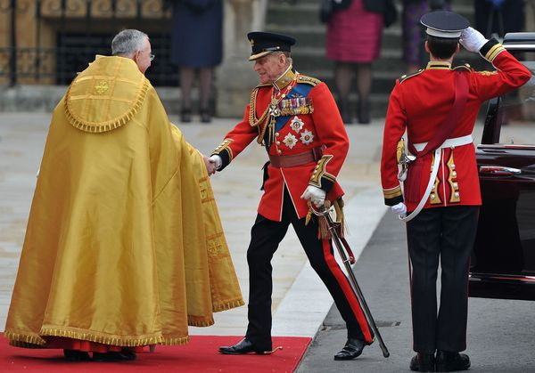 Prince Philip shakes hands with The Right Reverend Dr. John Hall, Dean of Westminster