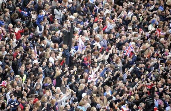 Well wishers wave to the camera during the royal wedding.