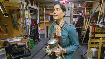 PORTLAND, ME - OCTOBER 11: The Maine Tool Library allows subscribers to utilize any of the tools and other items that they stock in their Anderson Street store room. Peggy Grodinsky looks to check out a meat grinder, one of hundreds of items availabe at the library. (Photo by John Ewing/Portland Press Herald via Getty Images)